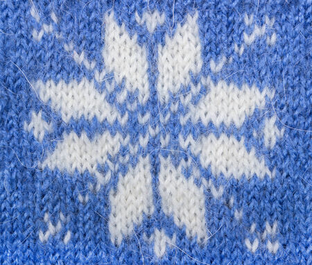 jacquard: Jacquard pattern. Knitted fabric blue color with snowflake. Stock Photo