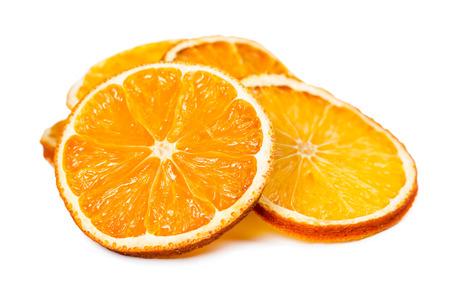 Dried orange slices isolated on white background.