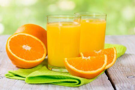Fresh orange juice on a wooden background photo