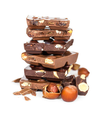 Chocolate pieces in a pile isolated on white background photo