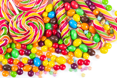 Colorful candies and lollipops on a white background photo