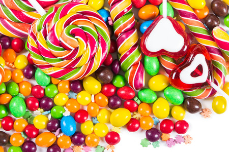 Colorful candies and lollipops on a white background Stock Photo