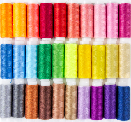 sewing cotton: Background from bobbins with multicolored thread for sewing