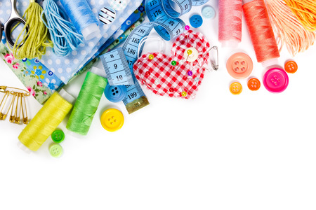 fabric cotton: Materials and accessories for sewing - fabric, pins, thread, buttons and measuring tape isolated on white background