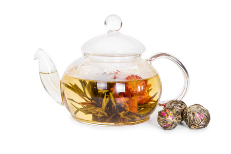 flowering: Chinese flowering tea in a glass teapot isolated on white background