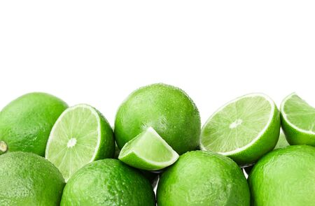 Fresh ripe limes isolated on white background