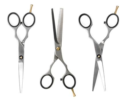 Set of hairdressing scissors isolated on white background