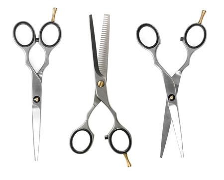 tijeras: Conjunto de tijeras de peluquería aisladas sobre fondo blanco