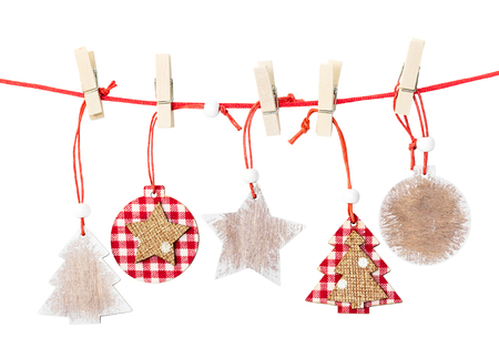 christmas decorations with white background: Christmas wooden decorations hanging isolated on white background Stock Photo