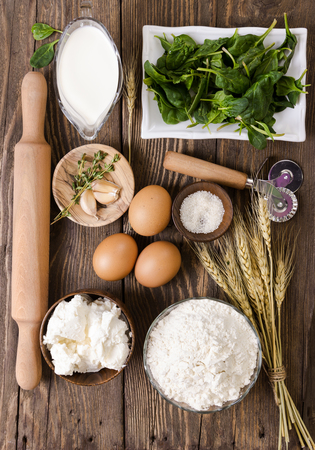 ricotta cheese: Ingredients for ravioli with spinach and ricotta cheese on wooden background Stock Photo