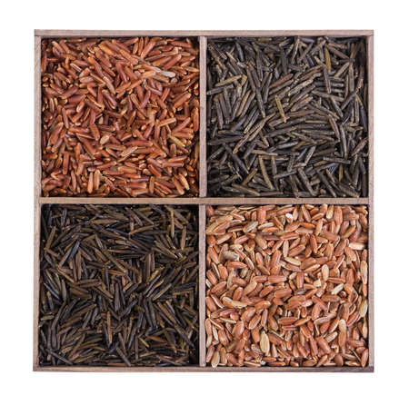 unpolished: Set of rice in a wooden box. Unpolished brown wild rice.