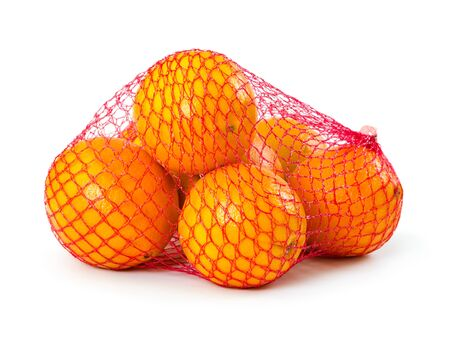 Fresh oranges in plastic mesh sack isolated on white background