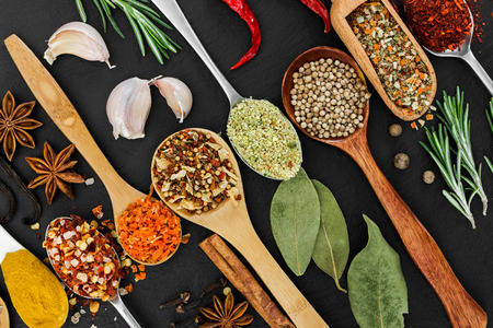 seasonings: Fragrant seasonings and spices on black background. Top view.