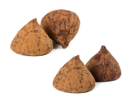 sprinkled: Set of chocolates truffles sprinkled cocoa isolated on white background