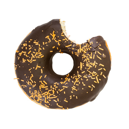 Bitten chocolate donut isolated on white background. Top view.