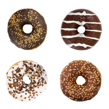 Set of chocolate donuts isolated on white background. Top view. Standard-Bild