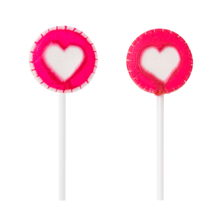 Two raspberry lollipop with heart isolated on white background. Stock Photo
