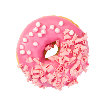 Strawberry donut with pink glazes, pink chocolate chips and pearl beads isolated on white background. Top view. Stock Photo