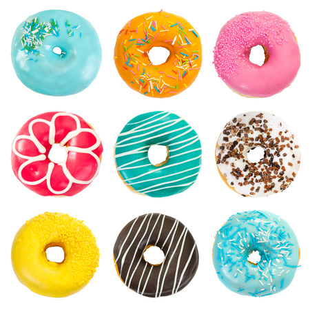 Set of various colorful donuts isolated on white background. Top view. Фото со стока