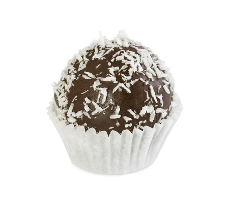 Chocolate cake ball with coconut chips in paper form isolated on white background