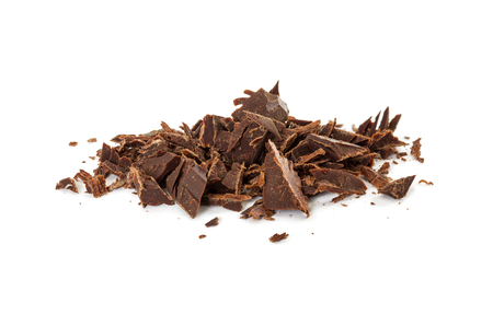 Chocolate shavings of bitter chocolate isolated on white background. Foto de archivo