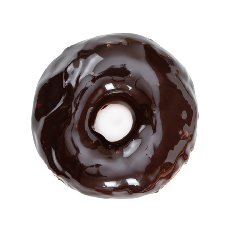 Donut with glossy mirror chocolate glaze isolated on white background. Top view.