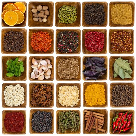 Set of spices in wooden bowl isolated on white background. Top view. Stock Photo