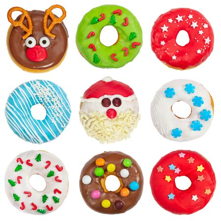 Set of Christmas donuts isolated on white background. Christmas and New Year celebration concept. Top view. Stock Photo