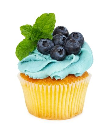 Cupcake with fresh blueberries and mint isolated on white background. 写真素材