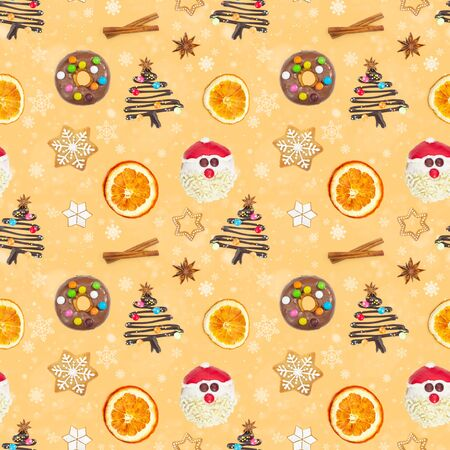 Seamless pattern with gingerbread cookies, Santa Claus, donut and Christmas tree on yellow background with snowflakes.