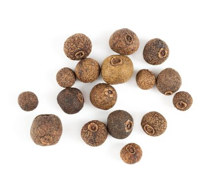 Allspice isolated on white background. Top view. Stock Photo