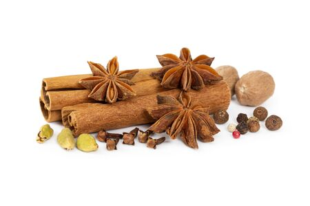 Cinnamon, star anise, cardamom, nutmeg, cloves and mixture of peppers isolated on white background. Seasoning mixture. Stock fotó