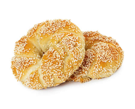 Two turkish bagels simits with sesame seeds isolated on white background.