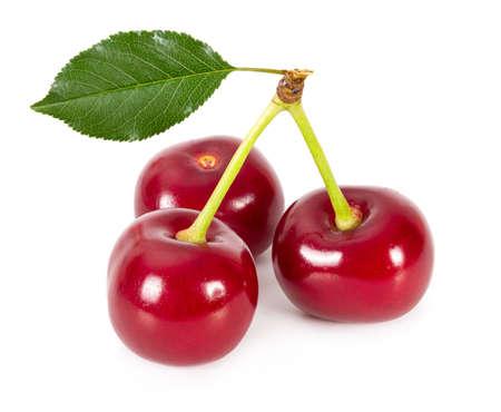 Three ripe cherries isolated on white background. Stockfoto
