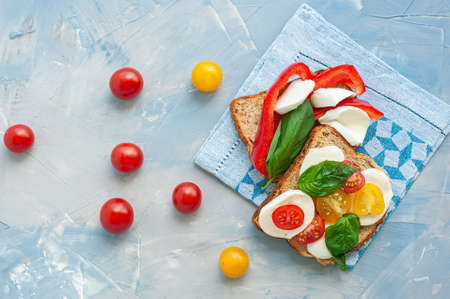 A light summer snack of toast with vegetables and cheese.