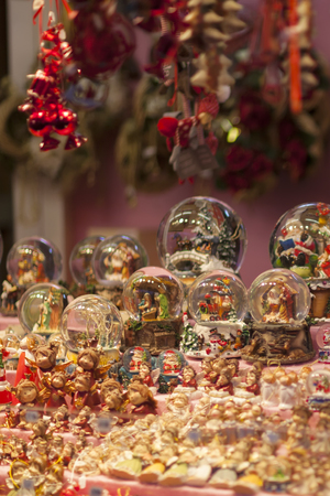 Christmas snow globes souvenirs on the advent market stall, close up