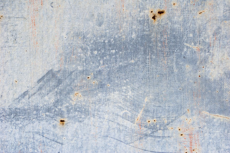 Unevenly colored wall. Paint smears on wall texture. Grey abstract background