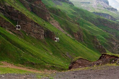 Ropeway in Caucasus Mountains. Cable car in mountain. Beautiful mountain landscape of Caucasus.