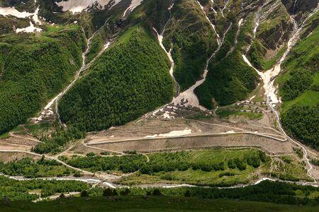 View of Baksan gorge. Rapid mountain river Baksan flows through gorge. Thick green forest slopes. Caucasus Mountain Stockfoto - 130673956