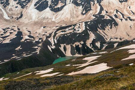 Lake Donguz-Orun Kel. Elbrus region. Turquoise lake in snowy mountains Фото со стока
