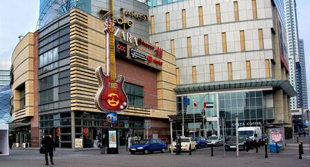 hard rock cafe: WARSAW, POLAND, FEBRUARY 14, 2016 - Development of city infrastructure in Poland. The image shows modern view of Warsaw with Hard Rock Cafe, shopping mall, skyscrapers on the background.