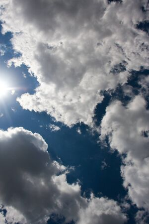 white gray clouds in the blue sky with sun Stock Photo - 11057201