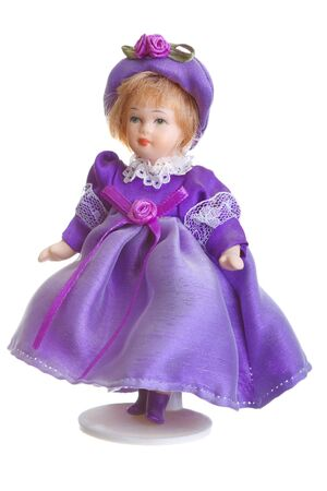 Porcelain Doll in purple dress isolated ovet white photo