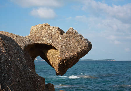 stone rock  background blue sky and turquoise sea