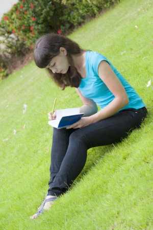 attentiveness: woman student near university with notebook on the lawn Stock Photo