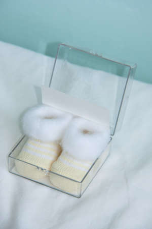 two soft beige newborn shoes baby bootees Stock Photo