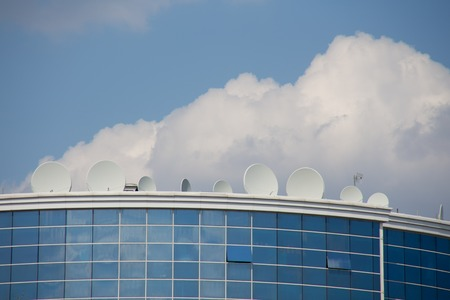 satellite plates on the building with sky Stock Photo