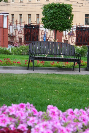 metall lamp: bench at the park acros from building