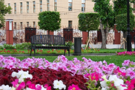 metall lamp: bench and flowers at the city garden