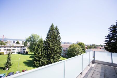 balcony in Swiss apartment blue sky
